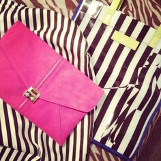 Love the pink suede clutch