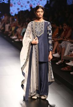 Navy blue floral embroidered kurta and palazzo pants set available only at Pernia's Pop Up Shop.