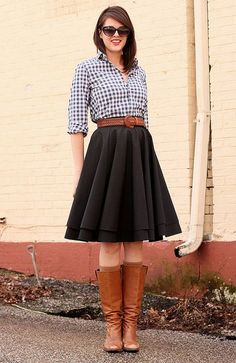 button up, full skirt, wide leather belt, tall boots