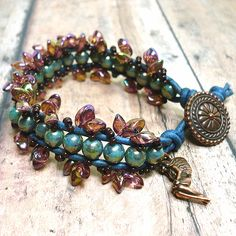 """Rich colors of copper, green turquoise, deep Pacific blue and rainbow topaz make for a striking BOHO leather wrap bracelet.  I have called this piece """"Iridessa's Enchantment"""" due to the shimmering fin"""