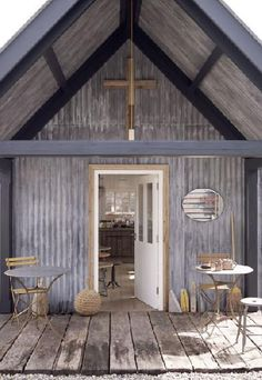 Galvanized and reclaimed tearoom (not a house)...would love these materials on a shed or house though.
