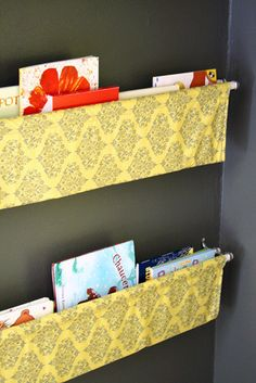 I'm guessing double hung curtain rods would do it - making book slings for the wall along the side of Liam's bed.  LOVE!