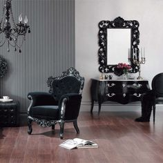 black carved wood, black velvet upholstery and a lovely chandalier