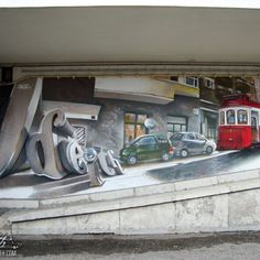 Solid Graffiti Letters and Traditional tourists Lisbon red Tram Mural Odeith Lisboa Portugal