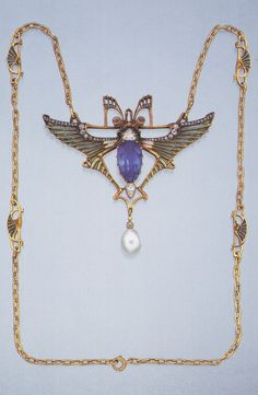 Lucien Gautrait - EGYPTIAN REVIVAL GOLD, PLIQUE A JOUR, DIAM,OND AND PEARL NECKLACE. The pendant as a scarab with sapphire and diamond body, plique-a-jour enamel and diamond wings bordered with rose diamonds, pearl drop, the chain set with lotus leaf moti