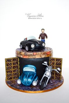 Edible silver BMW cake with number plate and a windshield The