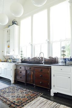 Unique idea of using an old dresser as a showpiece in the kitchen as a sink
