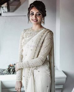 girls! The Bridesmaids are not to be ignored, this wedding season. After all, they are the ones stealing the spotlight after the couple getting married. In an Indian traditional wedding, there are a number of ceremonies to be held apart from the wedding. So, VenueMonk brings you some apparel trends, straight from the ramp! Let's have a look: South Indian Blouse Designs, Bridal Blouse Designs, Sari Design, Lehenga, Anarkali, Sharara, Saree Blouse Patterns, Saree Blouse Designs, Full Sleeves Blouse Designs