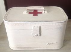 Recycle, reuse, repurpose & refurbish.  Here's a vintage looking First Aid kit using an old suitcase and homemade chalk paint.