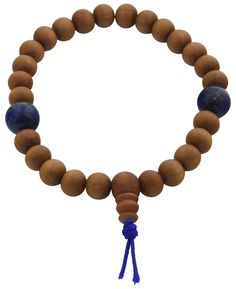 Stretchy wrist mala with sandalwood beads and stone counters of lapis or onyx. 27 beads total. Made in the USA.