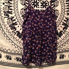 Navy blue floral romper This is a size small romper but it fits more of like an xs. From wet seal it has pockets and string bow at the waist. UO just for views Urban Outfitters Other