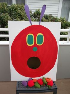 The Very Hungry Caterpillar game. Throw the fruit into the caterpillars mouth.
