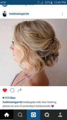 Wedding hair loose romantic soft curls low updo