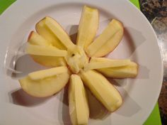 Apple flowers with cheddar.  Cut one organic apple with an apple corer.  Break off most of the core.  Push the center and it comes right off.  Top with thin little bits of cheddar.  Crispy, crunchy, sweet, juicy and oh my...the BEST dessert ever.