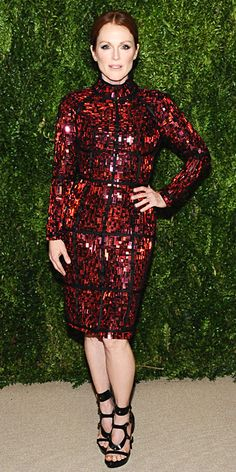 Julianne Moore struck a pose in a red embellished Tom Ford dress with black trim and strappy black sandals