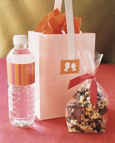 This couple designed guest room gift bags to hold bottled water, chocolate-covered popcorn, a Florida lottery ticket, and an itinerary of wedding events.