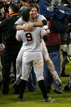 Brandon Belt #9 hugs Ryan Theriot #5 of the San Francisco Giants after defeating the Detroit Tigers to win Game Four of the Major League Baseball World Series at Comerica Park on October 28, 2012 in Detroit, Michigan. The San Francisco Giants defeated the Detroit Tigers 4-3 in the tenth inning to win the World Series in 4 straight games