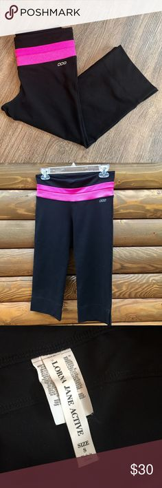 Lorna Jane cropped athletic pants Almost new! Worn once, just a little too small. Size small, pink waistband, cropped leg with side slits. Back zipper. Excellent quality! Great for yoga, workout, or running. Lorna Jane Pants