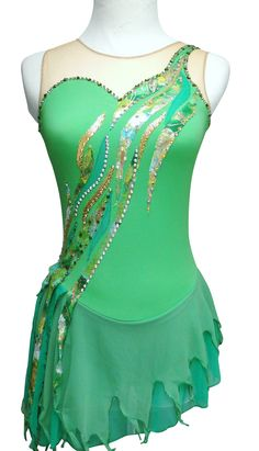 www.sk8gr8designs.com Peter Pan's Tinkerbell Figure Skating Dress, Sk8 Gr8 Designs in apple green with gold,kelly green, and lace appliques, tattered skirt, and Swarovski rhinestones in olivine, peridot, crystal AB, citrine and golden shadow.