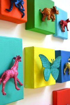 Dollar store toys, stretched canvases, paint, and glitter...  adorable, fun, simple artwork for a kids room (or even an adults!).