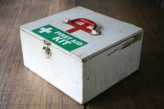 First Aid Kit Mid-Century Amazing Wooden Antique Medical Box with Compartments and Original Bottle by FoundByHer on Etsy https://www.etsy.com/listing/272660482/first-aid-kit-mid-century-amazing-wooden