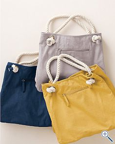 Beach bag with rope handles. I'd like to try to make one of these. Maybe I could find a similar pattern?