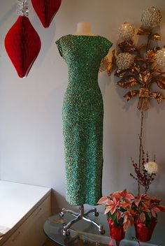 Behold the incredible beadwork on this 1960s emerald green evening gown by Giuseppe