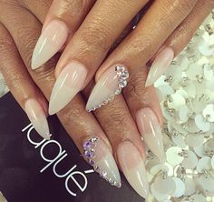 Clear stiletto nails with cute bling!