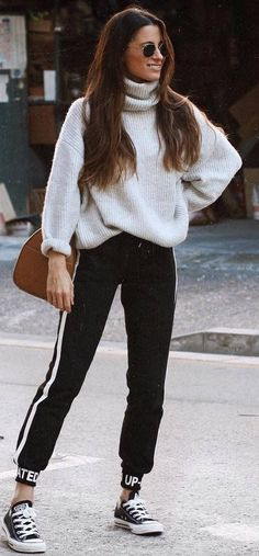 awesome winter outfit / sweater + bag + stripped pants + converse
