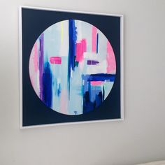 80cm round canvas mounted on midnight blue board in a white frame.