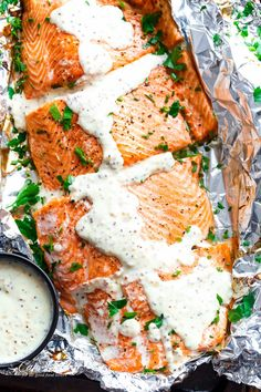 Garlic Salmon In Foil With Honey Mustard Cream Sauce - an easy and quick baked salmon recipe. Minimal clean-up thanks to the foil!