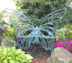 Gorgeous butterfly bench.  I would love to have one of these in my garden!
