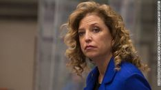 Democratic National Committee Chairwoman Debbie Wasserman Schultz faced intense pressure Sunday to resign her post and was meeting with party honchos about her future, several Democratic leaders told CNN, urging her to quell a growing controversy threatening to disrupt Hillary Clinton's nominating convention.