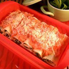 Lasaña enrollada de espinacas, queso y piñones