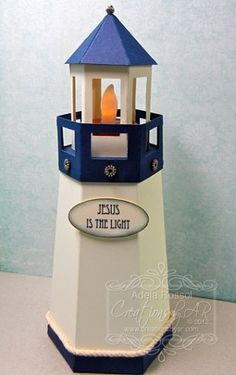 "Lighthouse... This lighthouse template is a box that stands 8"" tall with a lid designed to hold a battery-operated tea light. Great as a centerpiece or decor!"