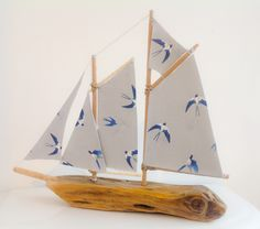 'Swallowtail', a driftwood sailboat commissioned by a loving mum for a gift at  her daughter's wedding. Inspired by the poem 'Wedding' by Alice Oswald (1996). Gorgeous fabric from a collection by Sophie Allport. She measures approx 12ins from the tip of her bow to her stern and is about 11ins to the tallest point of her mast. She has a little hole running through her side but will never, ever sink ;-) Driftwood boat, sailing, yachting, sailboat