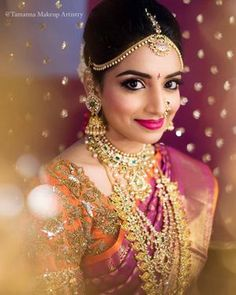 South Indian bride with gold jewellery and orange and pink kanjivaram. See more on wedmegood.com #wedmegood #indianwedding #jewellery #maangtikka #mathapatti #goldjewellery #southindianwedding #southindianbride