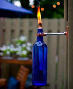 ideias para reaproveitar garrafas de vidro na decoração -Tocha