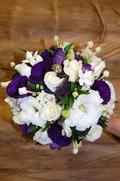 A purple and white bridal bouquet including lisianthus, roses, bouvardia and trachelium by Bella Vista Flower Merchants.