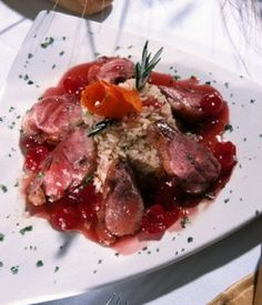 Duck with sauce of dried cherry, chicken giblets and port wine