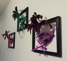 I couldn't figure out how to frame my mardi gras masks without flattening and ruining them. Then a quick trip to Wal-Mart and about $5 later, I've got 3-D wall art that I absolutely love!!!! Simple black picture frame minus the glass and back (they were actually sold that way), throw in a few nails, some beads and you've totally transformed your wall into a mardi gras party in about 15 minutes!