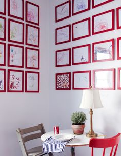 In this dining room from A Cup of Jo, a series of kids' drawings hung in inexpensive, colorful frames makes a big statement.