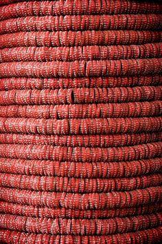 red bottle caps --in coils. Zemog, Bottle cap art