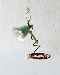 Vintage Industrial Clip Clamp Lamp - Pastel Aqua Green Light with Brown Color Cord and Plumen Bulb. $325.00, via Etsy.