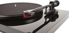 """Pro-Ject Debut Carbon Turntable with Ortofon 2M Red Moving-Magnet Cartridge  Type: Belt drive, unsuspended turntable Speeds: 33.3, 45 (78 rpm pulley adaptor optional) Dimensions: 16.35"""" x 6.33"""" x 12.66"""" Weight: 12.4 lbs. Price: $399  SUMIKO AUDIO (U.S. Distributor)  2431 Fifth Street Berkeley, CA 94710 (510) 843-4500 sumikoaudio.net"""
