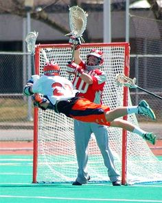 Liverpool senior attackman Derek Kreuzer gets air on a shot against Carthage on April 21, 2007.