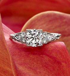 A stunning old mine cut diamond is set above a gorgeous floral motif platinum setting in this Retro-era engagement ring, while six sparkling accent diamonds decorate the sides (approx. Available in Platinum. Pretty Rings, Beautiful Rings, Vintage Engagement Rings, Vintage Rings, Wedding Engagement, Wedding Jewelry, Wedding Rings, Wedding Bells, Looks Vintage