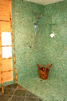 """ORGANIC BATHROOM, While shopping in Bali, we found this amazing vessel sink. It's natural beauty inspired me to design the entire bathroom around it. The sink is made from one piece of stone found in Indonesia. It was carved by hand by local artisans. I chose this faucet because when it's flowing it reminds me of a waterfall.,  The green pebbles on the wall came in 12"""" squares, while the rocks on the floor came in 20 lb bags.  I did not want to drill into the wall to mount a towel holder, so…"""