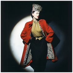 Model wearing wool jersey dress, red wool overcoat with leopard-stencilled lapin lining, and chechia, photo John Rawlings 1942