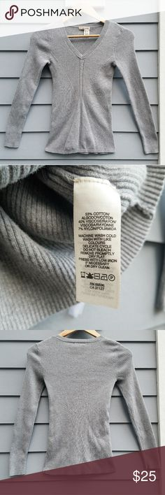 DKNY Soft Grey Sweater Uniquely contoured grey sweater from DKNY. Extremely flattering, and looks great with a favorite pair of jeans. In excellent, gently loved condition with zero flaws. Size small Dkny Sweaters V-Necks